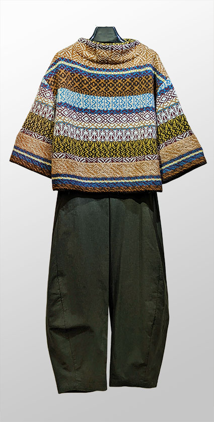 Catherine Andre multicolour knit wool sweater, over Oska cotton blend wide-leg trousers.