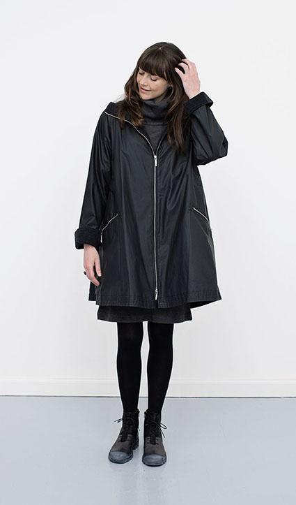 McVerdi hooded raincoat with adjustable waist and fleece lining.