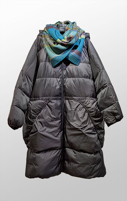 Rundholz Black Label onesize down puffer with elastic pockets and hood. Paired with Catherine Andre multicolour knit winter shawl.