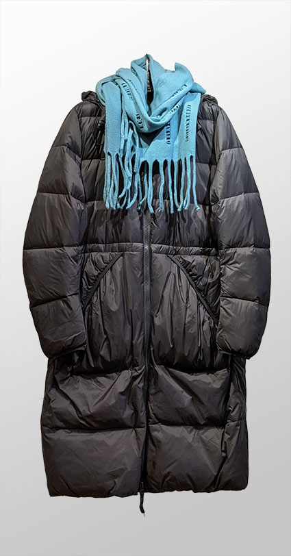 Rundholz Black Label winter down puffer with elastic pockets and hood. Paired with Catherine Andre openwork wool scarf with fringe.