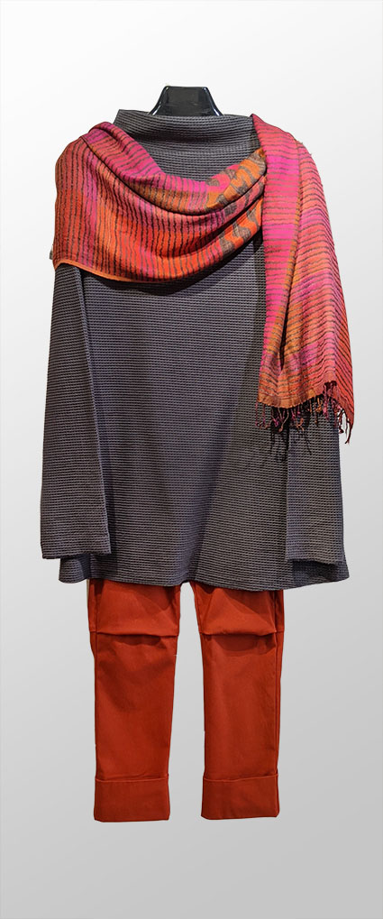 Elemente Clemente textured knit top in charcoal grey, over Vespa pant in new chili red colour. Paired with Neeru Kumar hand-woven 100% silk shawl in pink and orange tones.