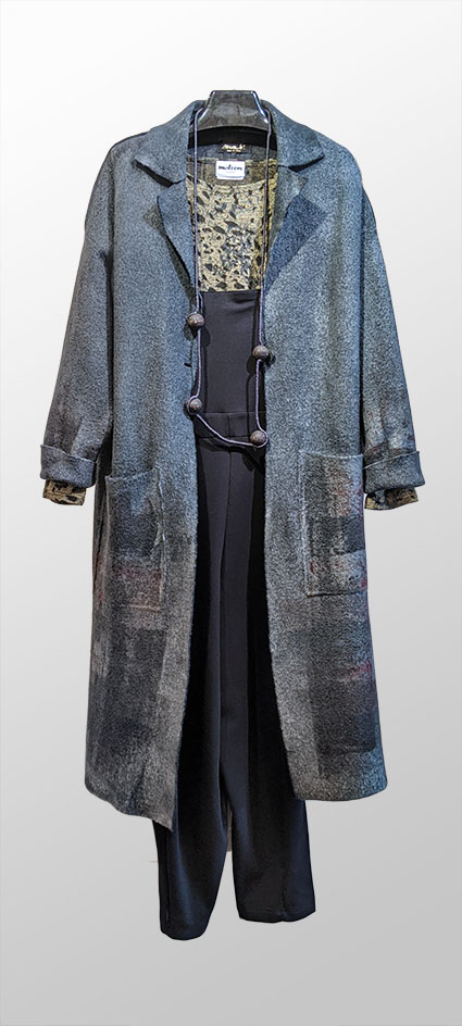 Mama B hand-painted boiled wool coat, over Motion graphic knit tee, and Mama B knit overall jumper.