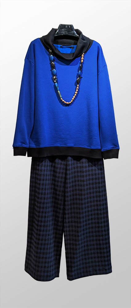 Elemente Clemente cobalt blue French Terry pullover with black rib knit cowl, over Elemente Clemente wide-leg navy and black check pants.