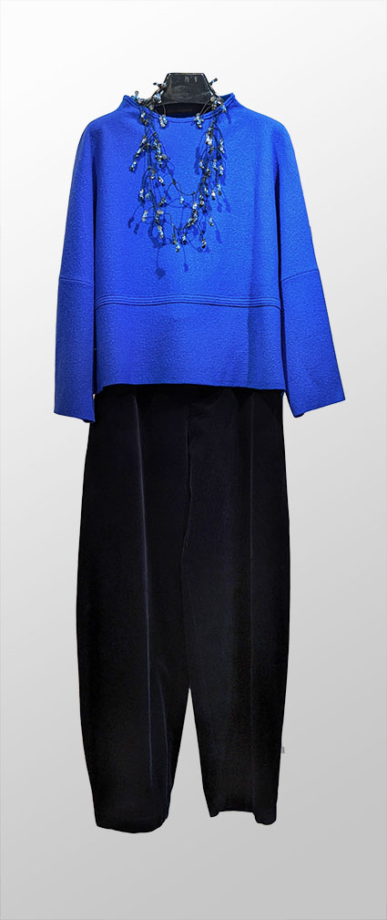 Elemente Clemente cobalt blue boiled wool pullover with funnel neck. Over Oska black corduroy trousers.