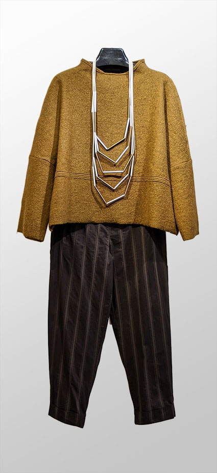 Elemente Clemente boiled wool knit top in antique gold. Over Elemente Clemente brown stripe tapered-leg pants in organic stretch cotton.