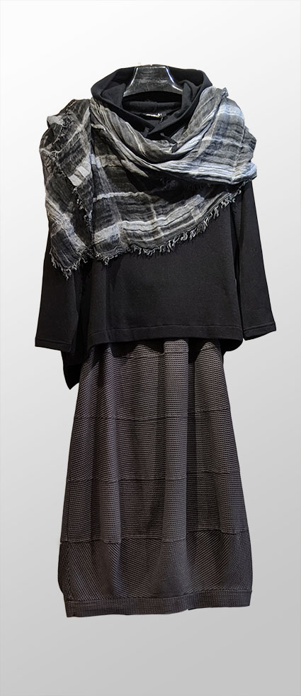 Mama B cozy knit hoodie in black, over Elemente Clemente knit bubble skirt in grey. With a Black Label textured stripe woven shawl in shades of grey.