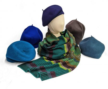 Kopka 100% merino wool berets in blue tones. Paired with a Catherine Andre wool-blend striped shawl.