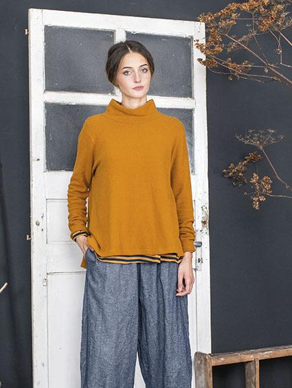 Mama B cozy knit turtleneck in butternut orange.