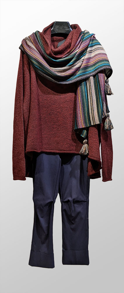 Rundholz Black Label oxblood red sweater, over Vespa pants in Cambridge blue. Paired with a Catherine Andre striped shawl with metallic and tassels.