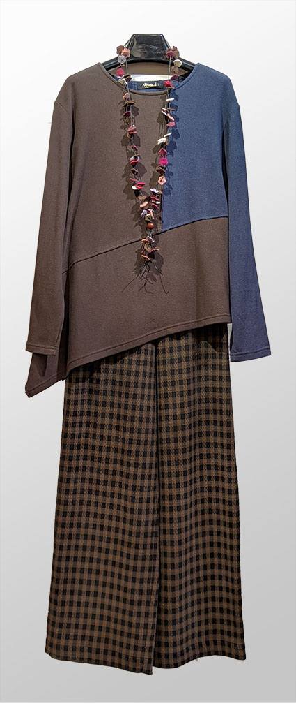 Mama B asymmetric oversized top in cozy knit fabric. Over Elemente Clemente cotton-blend wide-leg pants in brown check.