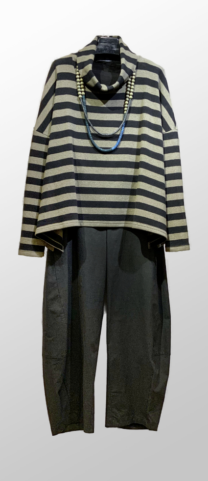 Neirami cozy knit oversized striped turtleneck, over Oska dark green cotton-blend trousers.