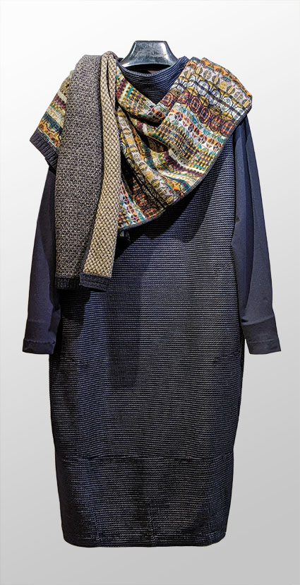 Elemente Clemente organic cotton blend knit dress in black, paired with Catherine Andre wool-blend reversible shawl in espresso tones.