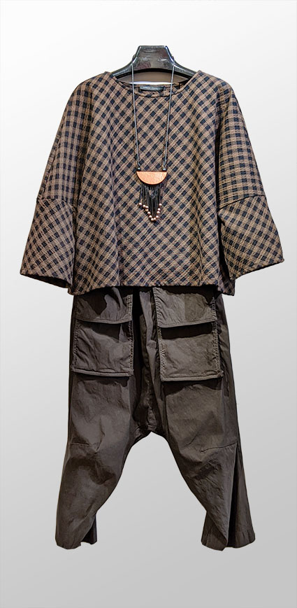 Elemente Clemente cotton-blend check pullover in black and brown, over Rundholz Dip drop-rise pants with oversize pockets, in dark brown.