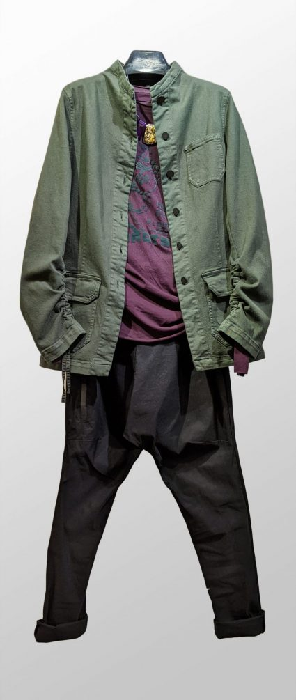Pal Offner khaki green twill jacket with adjustable sleeves, over Rundholz Black Label printed long tee, and Rundholz Black Label drop-rise pants in technical stretch, with big back pocket.