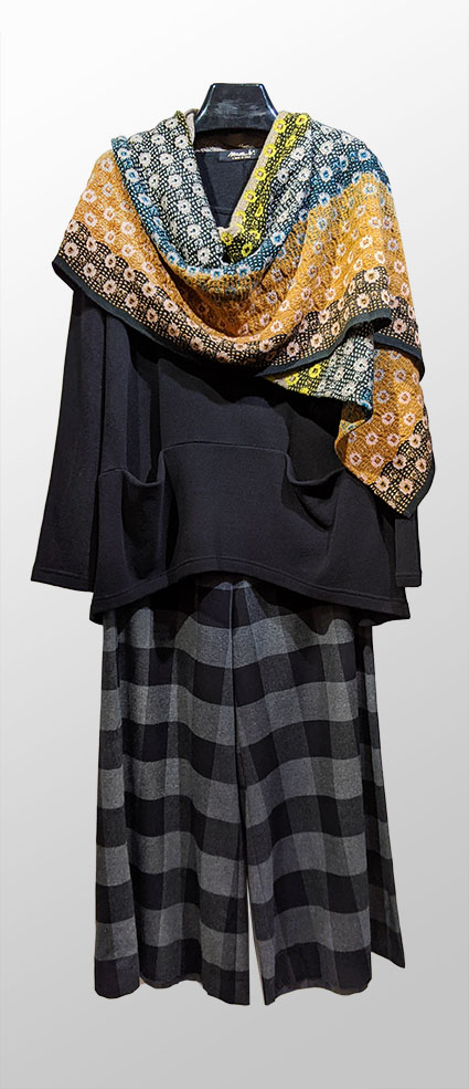 Catherine Andre millefiori wool scarf over Mama B cozy knit turtleneck. Paired with Mes Soeurs et Moi black and grey check wide-leg flannel pants.