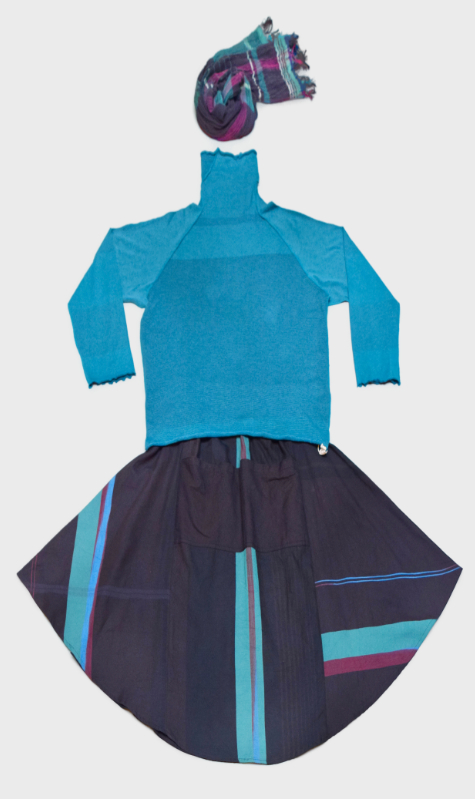 Tamaki Niime 100% cotton pieces. A soft jersey turtleneck layered with a full cotton-weave skirt with two pockets. Paired with a Tamaki Niime 100% cotton gauze scarf.