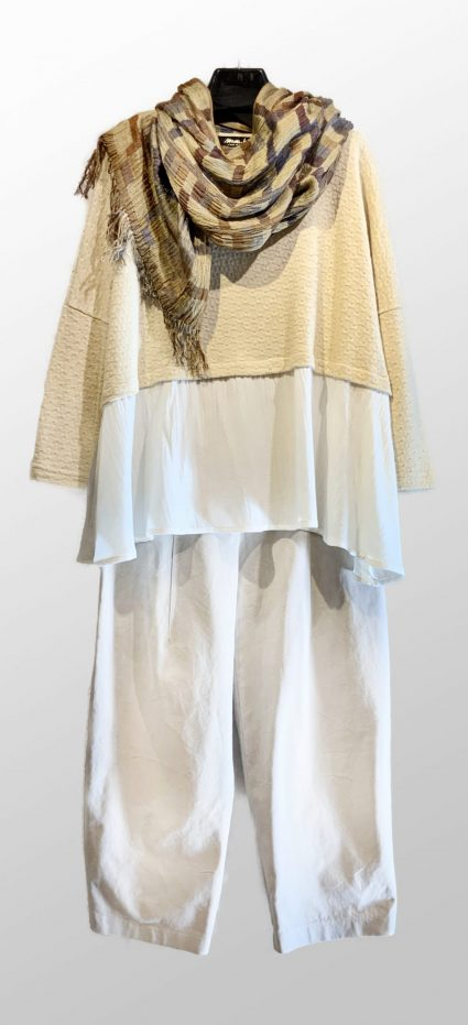 Mama B cream eyelet knit top with a peplum, over Neirami off-white cotton twill pants. Paired with a Neeru Kumar 100% silk shawl.