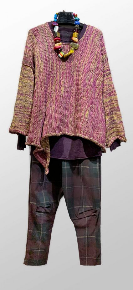 Skif knit sweater in berry and gold, over a Rundholz Black Label knit tee. Paired with a Rundholz Black Label check drop-rise pant, and a colorful Sobral necklace.