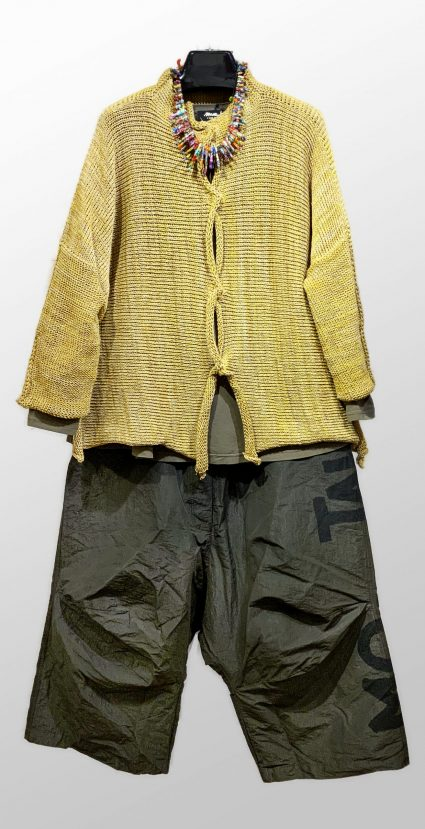 Skif straw-yellow knit cardigan, over a Mama B a-line tee in olive green. Over Rundholz Dip drop-rise pants.