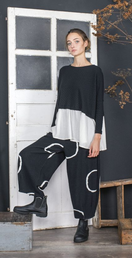 Mama B eyelet knit topper with a contrast fabric peplum. Layered over Mama B cozy flannel double knit pants.