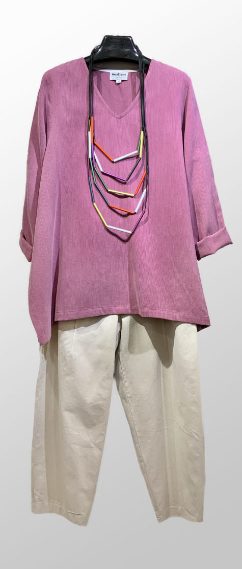 Motion dusty mauve tunic, over Neirami cotton twill trousers in Ivory.