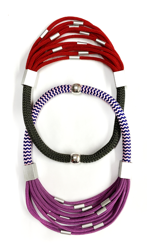 Cascading cord collars with aluminum beads.