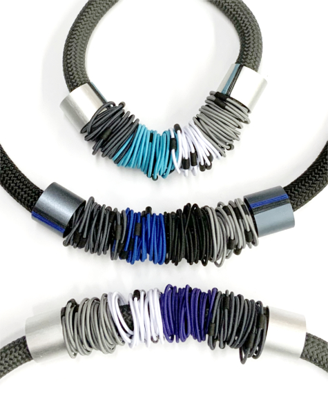 Thick cord collars wrapped in elastic, with aluminum beads.