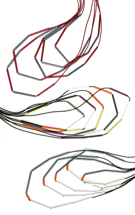 Long layered elastic necklaces in assorted colours of aluminum beads.