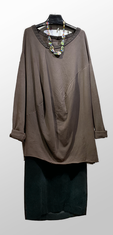 Rundholz Dip french terry asymmetric sweatshirt in brown, over a Mama B corduroy bubble skirt in black.