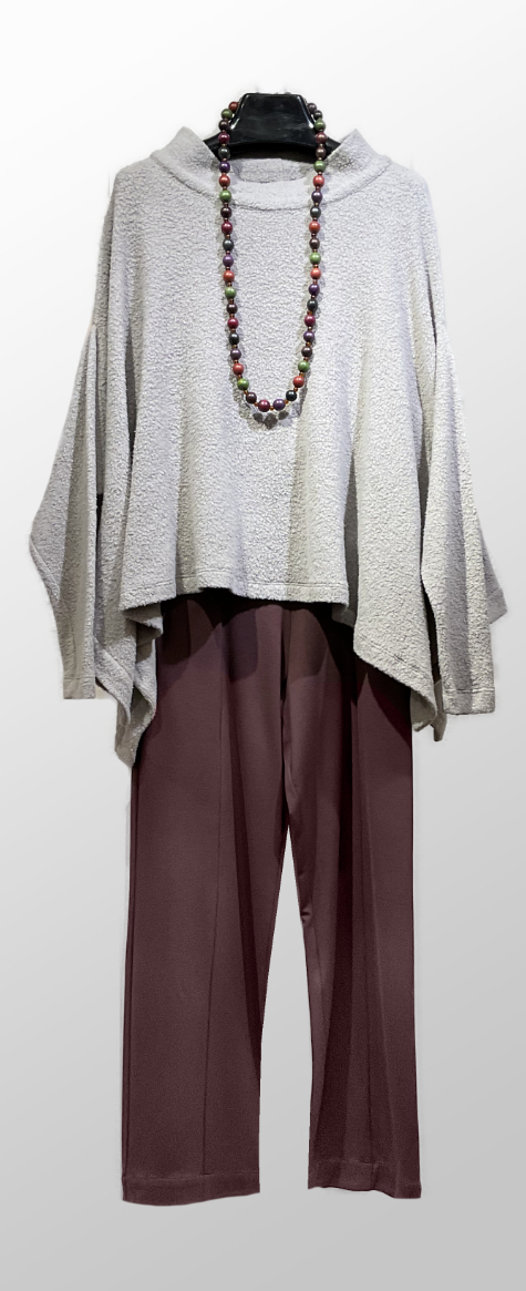 Mes Soeurs et Moi ash grey faux-shearling poncho sweater, over Mes Soeurs et Moi doubleknit trousers.