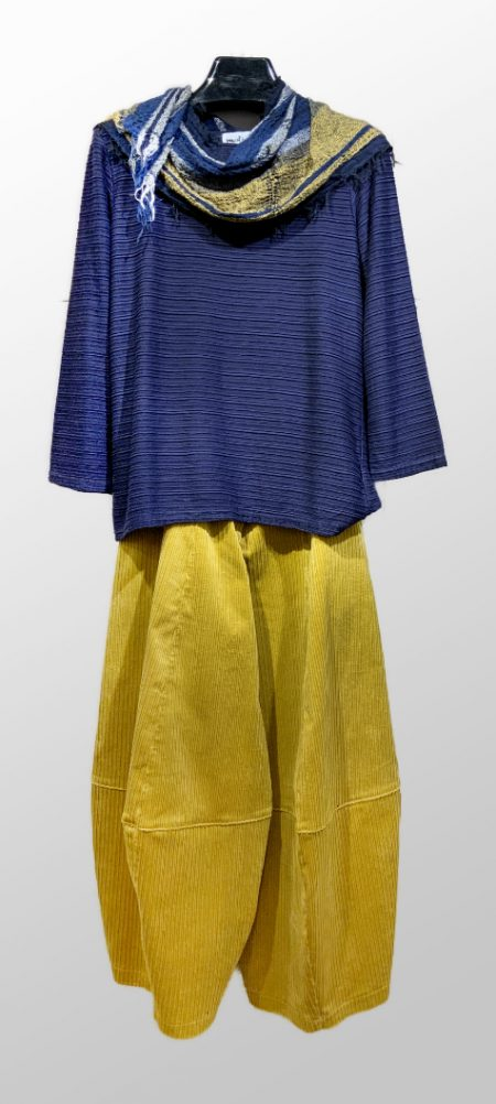 Motion textured stripe tee in Midnight blue, layered over Motion corduroy bubble pants in Pear yellow. Paired with a Tamaki Niime 100% cotton gauze small scarf.