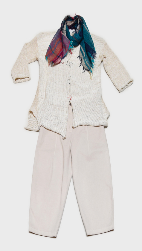 Skif cotton-blend cardigan in cream, with colorful hand-stitched snaps. Layered with Neirami cotton twill trousers, and paired with a small Tamaki Niime 100% cotton gauze scarf.