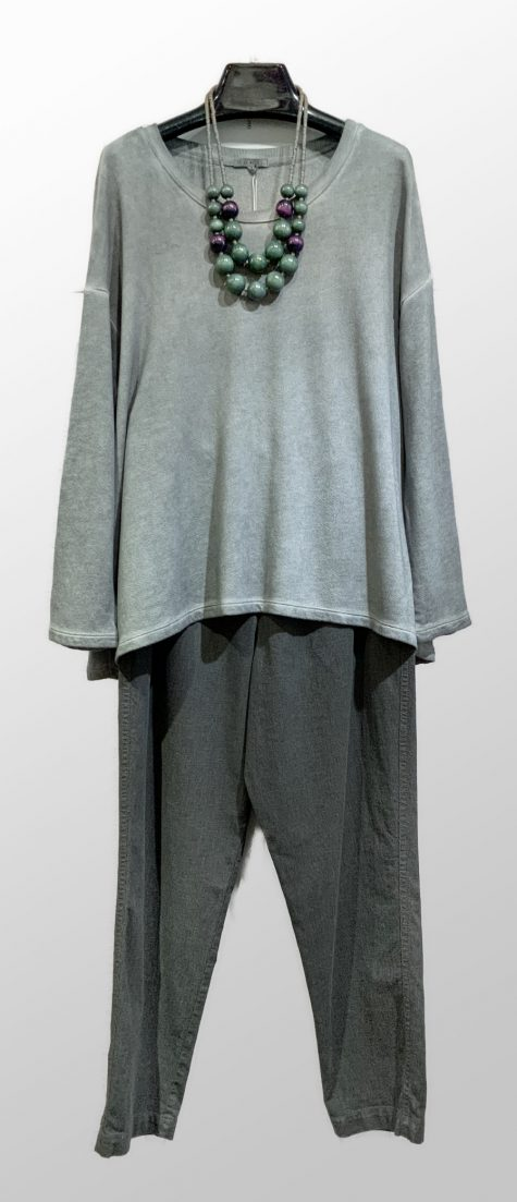 Garment-dyed fleece pullover over Oska woven cotton trousers in stone green.
