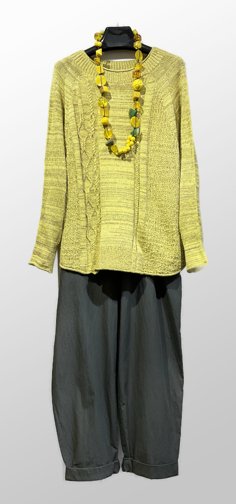 Tamaki Niime 100% cotton sweater, over Oska relaxed knit trousers. Paired with a colourful Sobral necklace.