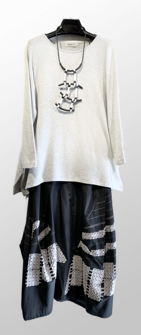 Mama B light grey cozy knit tunic, over a Noriem cotton-blend pieced skirt.