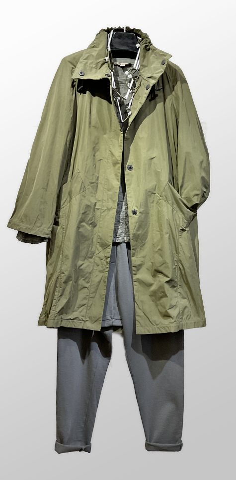 Mycra Pak a-line raincoat in khaki green, over a Flax textured weave linen tee, and Black Label drop-rise french terry pants.