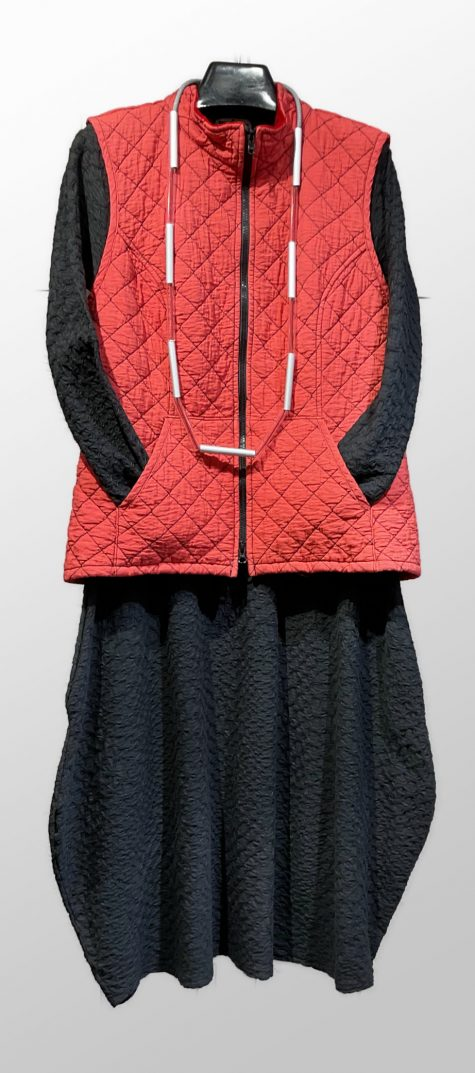 Motion quilted zip-up vest, over a Neirami textured knit bubble dress.
