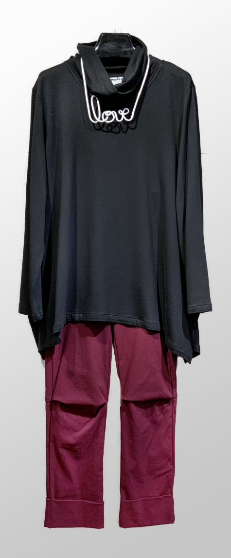 Motion french terry turtleneck, over Vespa pants in Dahlia red.