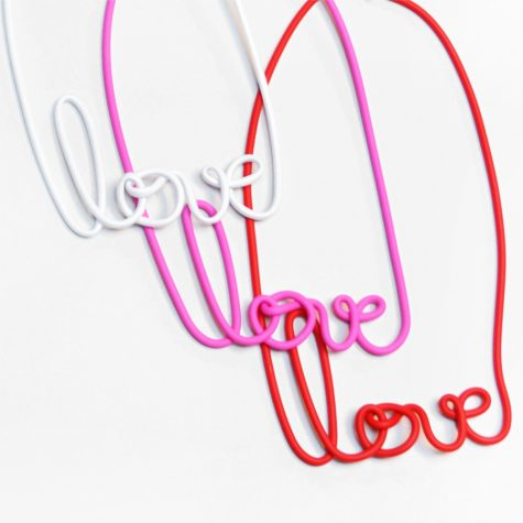 "Rubber and wire ""love"" collars in assorted colours."