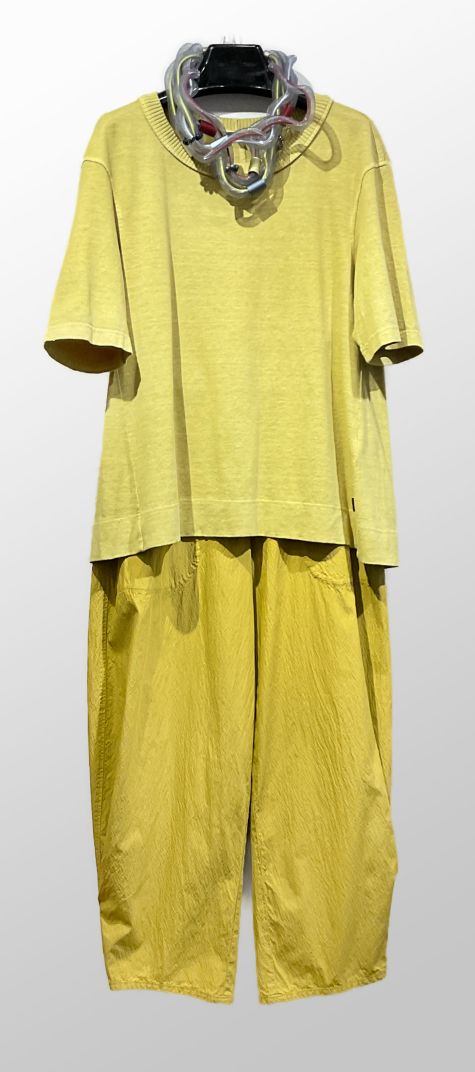 Oska garment-dyed cotton-hemp knit tee, over Oska lightweight cotton trousers in lemon yellow.