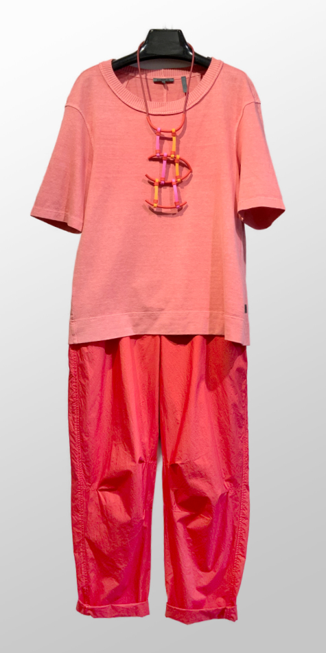 Oska hemp-blend garment-dyed tee, over Oska 100% cotton trousers in scarlet red.