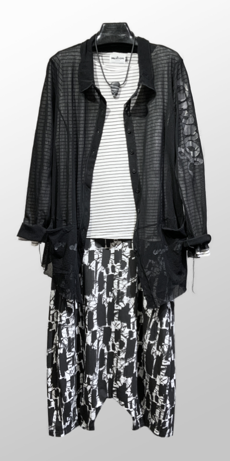 Rundholz Black Label cotton mesh blouse with a vinyl print, over a Motion striped tee. Paired with Mama B drop-rise knit pants.