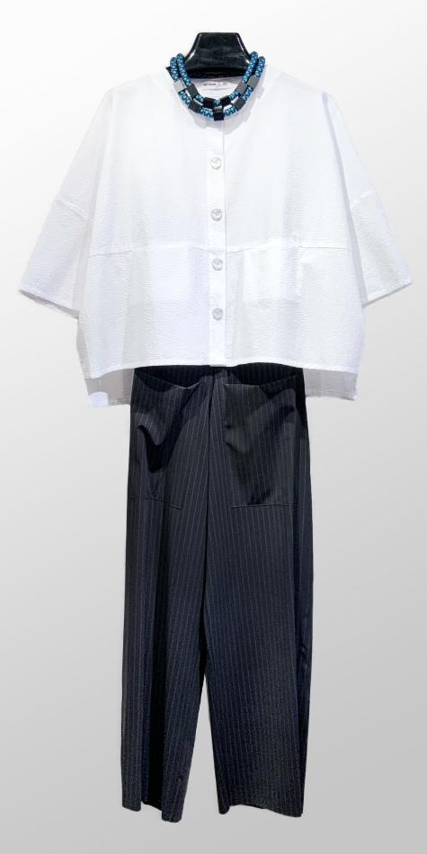 Mes Soeurs et Moi lightweight seersucker jacket, over Elemente Clemente wide-leg trousers in a technical knit pinstripe.
