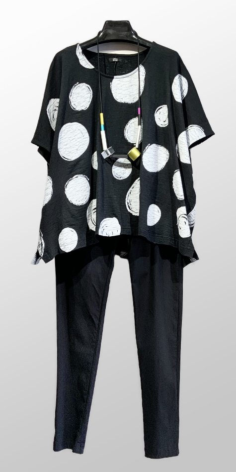 Moyuru boxy cap-sleeve tee in a dot print, over Rundholz Black Label slim-leg pants in technical stretch.
