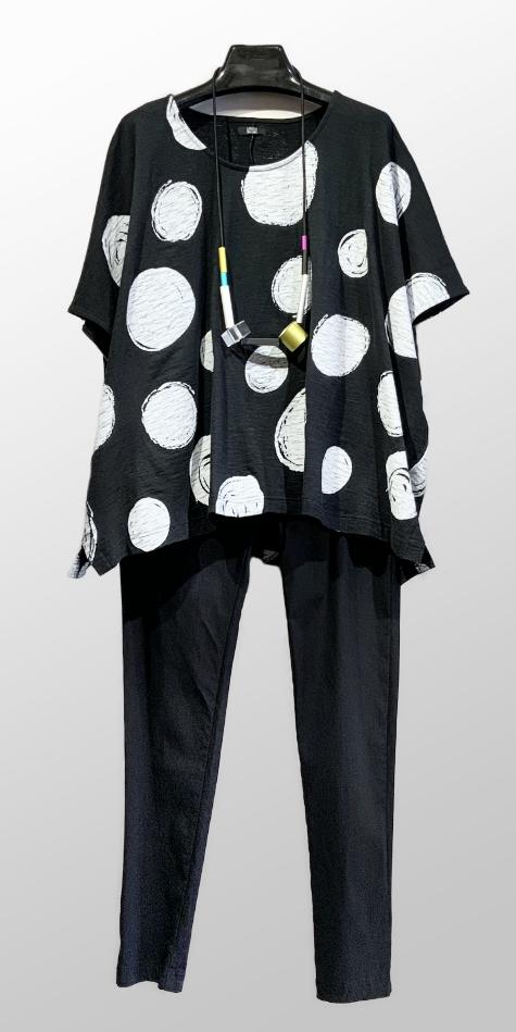 Moyuru boxy cap-sleeve tee in a dot print, over Rundholz Black Label slim-leg pants in technical stretch.