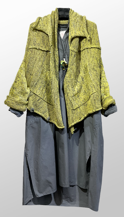 Skif long cardigan, worn upside-down, over a Hannoh Wessel cotton shirtdress with knit sleeves.