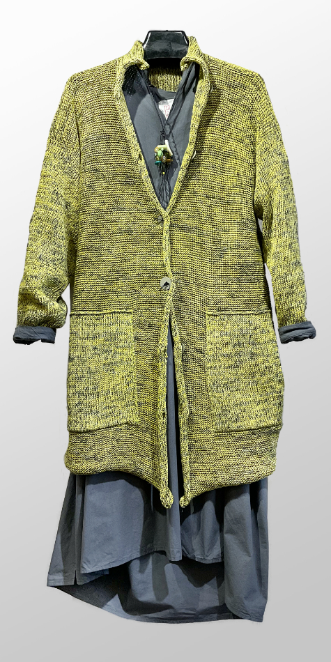 Skif long cardigan with pockets, over a Hannoh Wessel cotton shirtdress with knit sleeves.