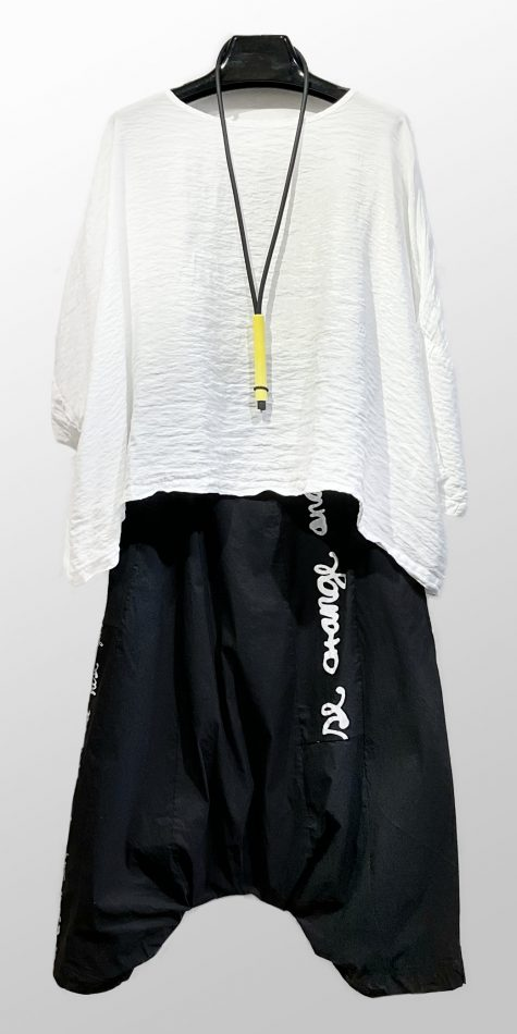Motion parachute rayon onesize top, over Black Label drop-rise printed pants.