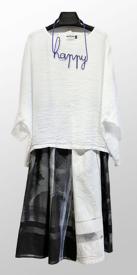 """Motion parachute rayon crop in white, over a pair of cropped Tamaki Niime 100% cotton wide-leg pants. Paired with a Samuel Coraux """"happy"""" necklace."""