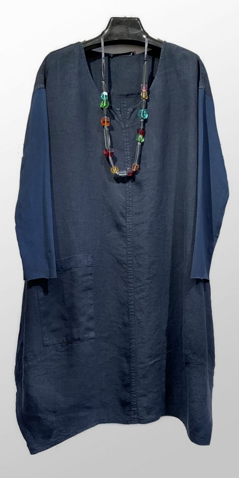 Elemente Clemente relaxed linen dress with long knit sleeves.